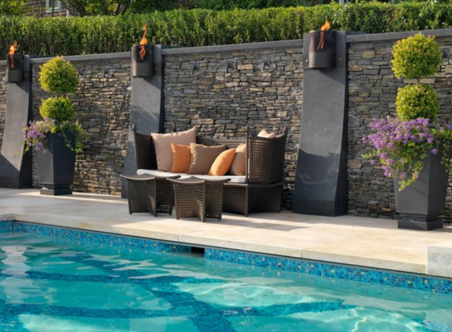 Stone cladding with travertine pool paving