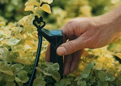 Micro spray irrigation system for garden beds