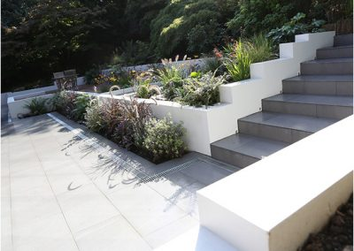 Rendered stepped retaining walls