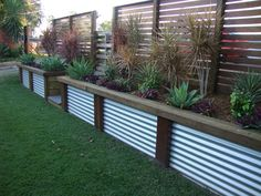 Retaining wall faced in mini orb with timber piers