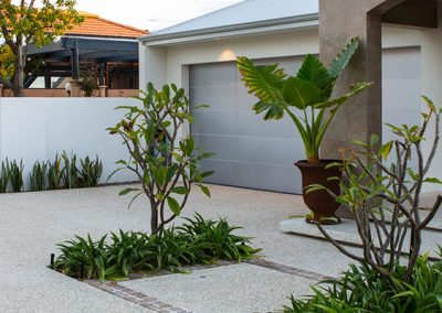 Exposed aggregate features in driveway