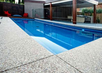 Exposed aggregate pool surround and paving