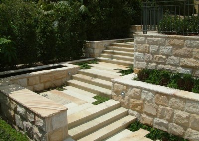 Sandstone retaining walls and steps and paving