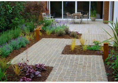 Granite cobblestone paving pathways and driveways