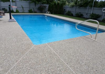 Exposed aggregate pool paving surrounds