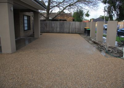 Residential driveway and portico in exposed aggregate
